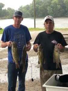 second place men catching fish