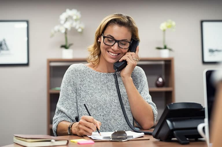 Woman-Smiling-on-Phone-IMG