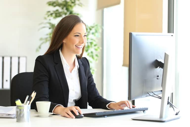 Woman-Smiling-with-Computer-IMG