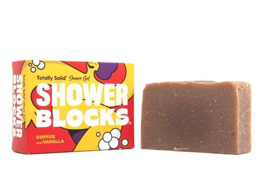 Shower blocks coffee & vanilla soap next to packaging