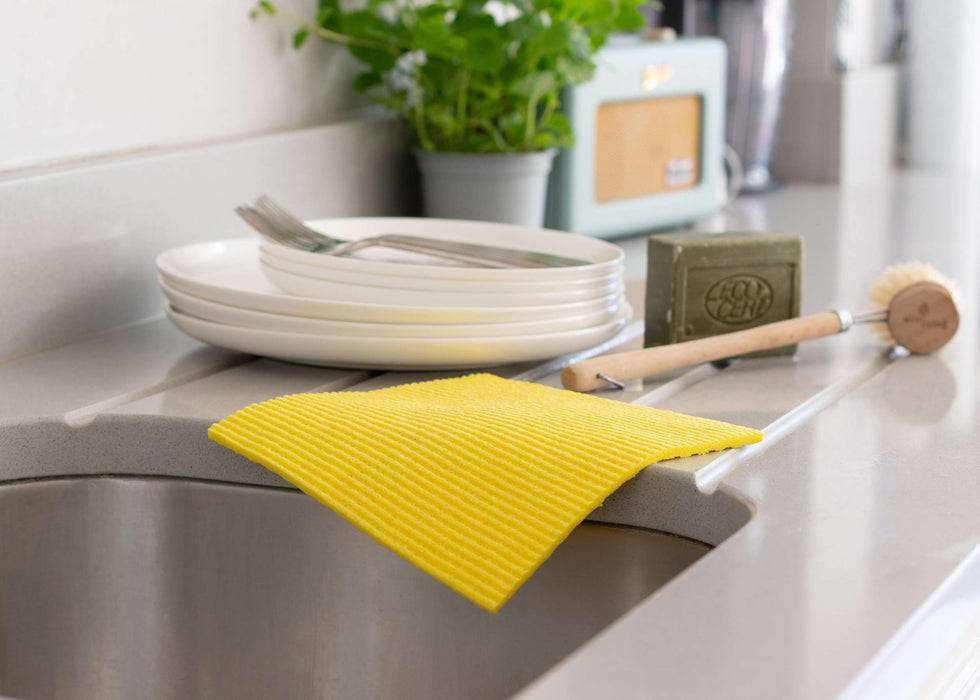 Eco Living Sponge Cloths Multicoloured Biodegradable Sponge Cleaning Cloths yellow on side of counter
