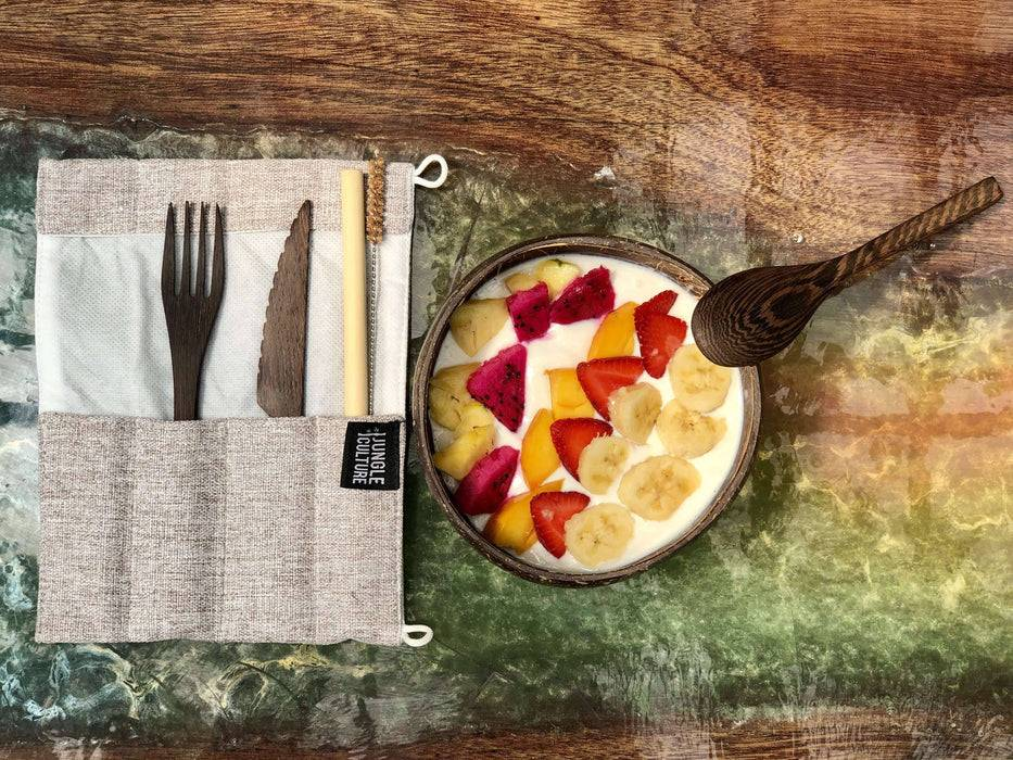 Jungle Culture Cutlery Set Hand carved reclaimed wooden cutlery set light grey set next to soup