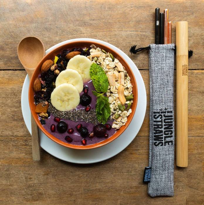Jungle Culture Steel Straws Reusable Stainless Steel Straw Set with Bamboo Carry Case top down view of straw set next to food
