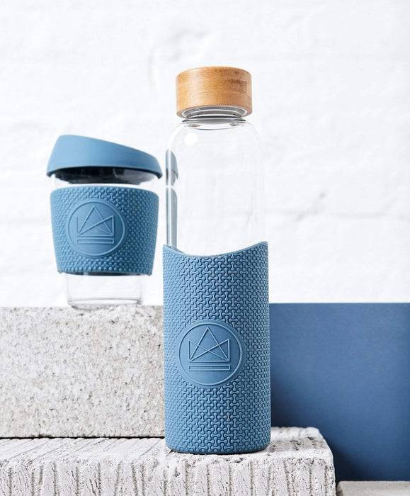Neon Kactus Coffee Cup Glass Water Bottle - Pastel Blue - 16oz Water Bottle bottle next to cup