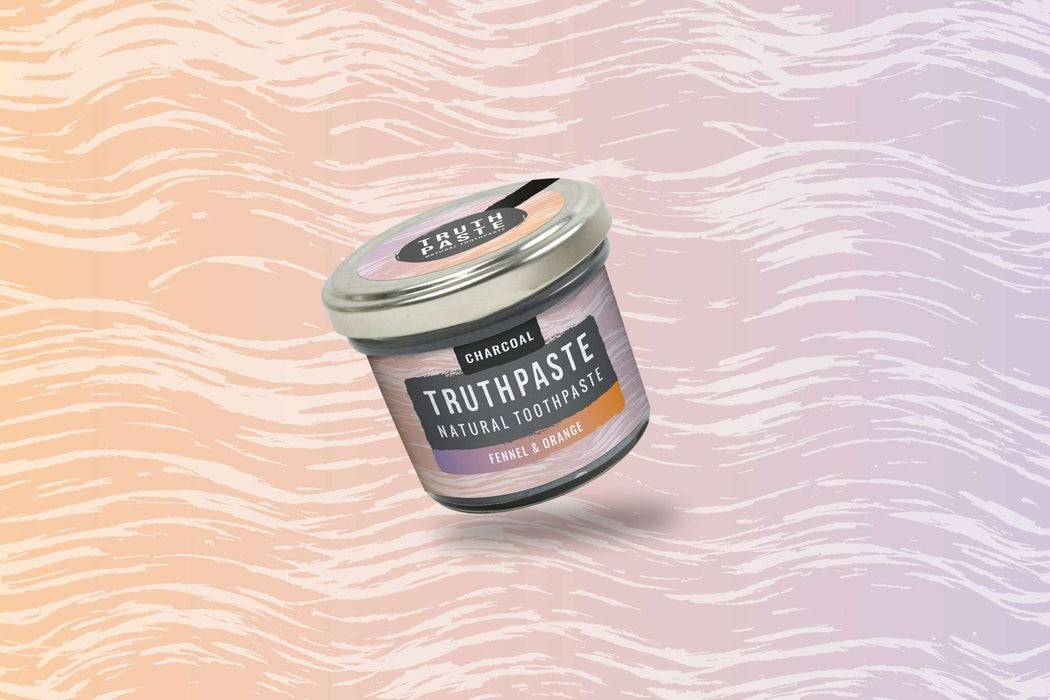 Truthpaste Toothpaste Natural Toothpaste Charcoal Orange & Fennel 120G - Truthpaste  far shot coloured background