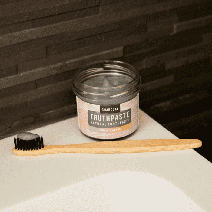 Truthpaste Toothpaste Natural Toothpaste Charcoal Orange & Fennel 120G - Truthpaste on sink with bamboo toothbrush