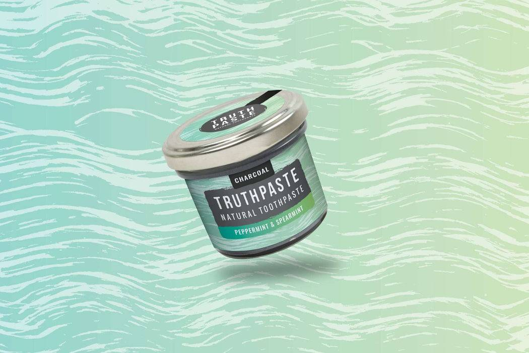 Truthpaste Toothpaste Natural Toothpaste Charcoal Peppermint & Spearmint 120G - Truthpaste  far shot coloured background