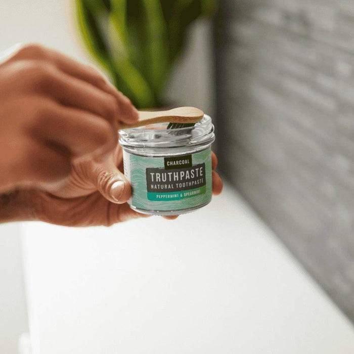 Truthpaste Toothpaste Natural Toothpaste Charcoal Peppermint & Spearmint 120G - Truthpaste being used with toothbrush