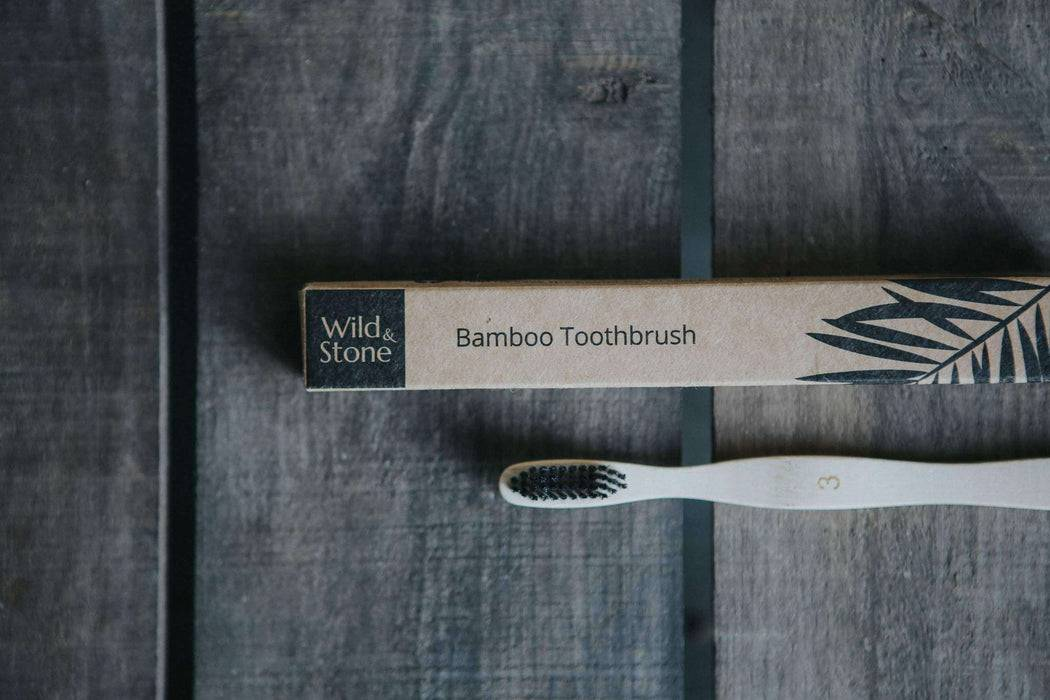 Wild & Stone Toothbrush Adults Bamboo Toothbrush - Medium Firm Bristles on table