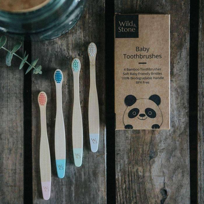 Wild & Stone Toothbrush Baby Extra Soft Bristles Bamboo Toothbrush next to cardboard
