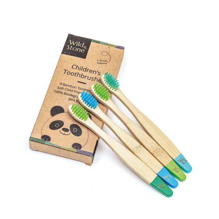 Wild & Stone Toothbrush Soft Bristles Bamboo Toothbrush - Children's - Aqua WS4-TTH-CHLD-BOY resting on packaging