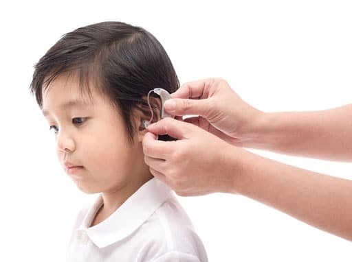 Child being fitted for hearing aid
