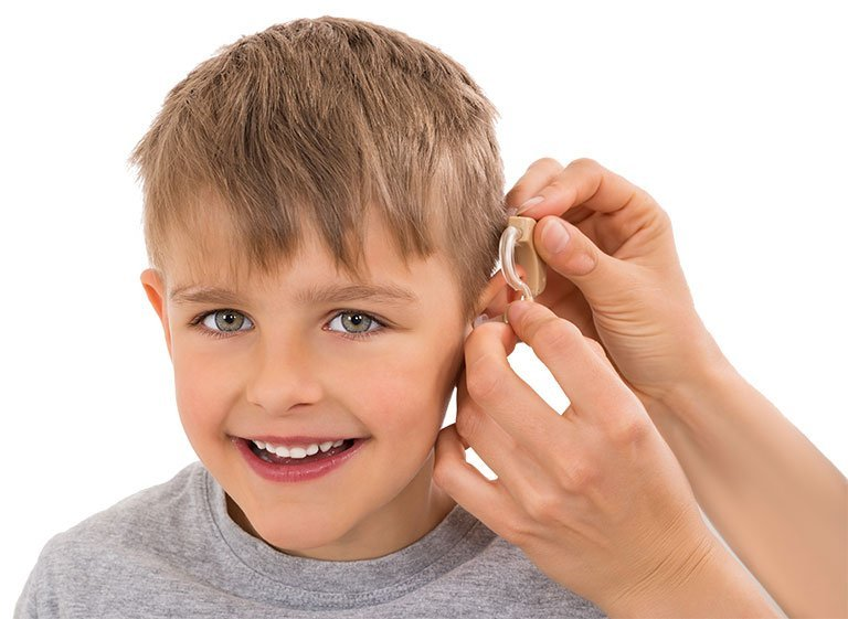 pre teen being fitted for hearing aid